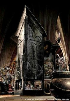 Vanishing Cabinet from Harry Potter- I could make a smaller version to keep stuff in somewhere in the house, and make it glossy black.