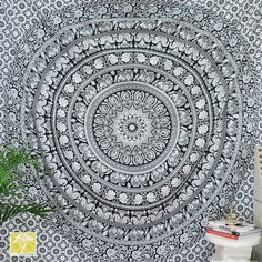 Black & White Mandala Tapestry. Add an ethnic feel to your room with this cotton handmade wall hanging. Go for a dramatic makeover of your wall and this tapestry would become a conversational piece of art. A must have in any season for all ethnic savvy ones. This is a rare beauty not to be missed, a genuine collector item showing the result of masterly workmanship.