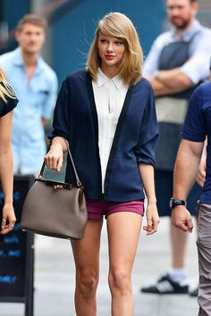 Taylor Swift. Wow she looks so mature in this picture.... ok so she is like 23 but still.