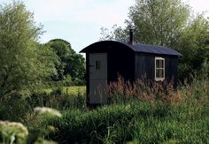 "Old shepherd's huts used to be a common sight in the countryside when they were towed to the field as temporary homes during lambing, with a bunk and essential kit. This authentic recreation in Dorset has a woodburning stove and oak flooring. ""Not much beats watching the sun set over the stable door,"" says owner Richard."