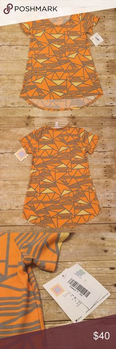 NWT LuLaRoe XS Classic T, orange/yellow triangles New with tags XS Classic T by LuLaRoe. Very flattering and very stylish! Perfect colors for this upcoming spring/summer season! Orange and yellow triangles, with gray outlining. Very versatile! Can be paired with several different colored leggings. Front length is approximately 25 inches, back length is approximately 29 inches. LuLaRoe Tops Tees - Short Sleeve