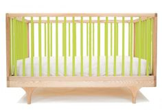 Looking for a unique crib? Check out this lime green crib from Kalon Studio. #crib #nursery
