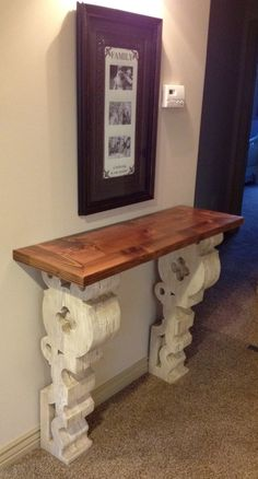 DIY:  How to Build this Restoration Hardware Inspired Entryway Table - this tutorial shows how to cut the corbels out of stock lumber and how to make this table that is a great space-saver and perfect for a narrow hallway.