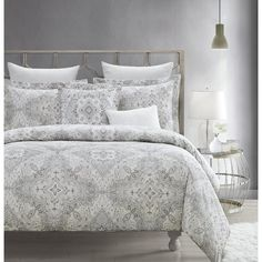 Transform your bedroom into a luxurious retreat with this comforter set. The soft, subtle bedding set features an elegant paisley medallion print in tones of gray.