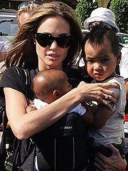 A wonderful humanitarian and Mother - Angelina Jolie with two of her little ones.
