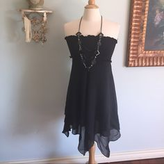 ⚡️⚡️flash sale ending quick then price goes back⚡️ Romantic 100%silk black dress from BCBG Maxazria❤️  In amazing condition.  Hand wash and cool iron easily takes care of this beauty for you.   Fitted tube top and gorgeous flowing silk will make this your soon to be favorite go to dress.   A classic piece with trendy asymmetrical bottom.   An obvious piece for summer. Stock up now as I'm no sure this will be here in the summer.   Preloved❤️ and still amazing.   Size small. BCBGMaxAzria…
