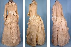 """This is a dress """"Stern Brothers"""" in 1883. From Grenadine and cream satin ribbon ties.  Rich  in detail."""