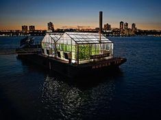 "The Science Barge greenhouse, floating on the Hudson River, grows an abundance of fresh produce with no carbon emissions, no pesticides, & no runoff. All of the energy it needs is generated by solar panels, wind turbines, & biofuels while the hydroponic greenhouse is irrigated solely by collected rainwater & purified river water, thus operating completely ""off the grid."" It is the only fully functioning demonstration of renewable energy supporting sustainable food production in New York."