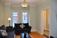This Hamilton home has stunning features throughout. Crown moulding, beautiful paint colour, modern hardwood.   http://www.walshandvolk.com/92-peter-street-hamilton/