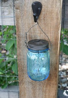 DIY solar lighting.  This is such a great and inexpensive idea for adding just the right amount of light to your garden.