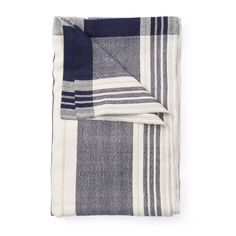 Story  An oversized alpaca wool blanket that re-imagines the traditional South American blanket  This everyday blanket is made from hypoallergenic alpaca wool that's dyed to a deep indigo accented with grey and tan. It's a modern interpretation of the beloved classic of South American living rooms, picnics and everything in between. The generous size spreads perfectly across the foot of a bed or the back of a couch.  Features   Design based on traditional South American blankets  Hand-loomed…