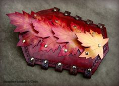 Autumn Splendor - Fantasy Armor Leather Bracers. $130.00, via Etsy. -Rassaku. Not a collar, I know - I just thought this was unusual and beautiful leatherwork from a clearly skilled craftsman.