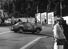 Spa 1971. Alfa Romeo 2000 GTA cornering on three wheels at La Source as a bored spectator looks the other way…