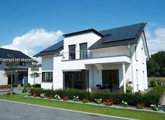 highly energy efficient house with solar panels on roof in Germany Energy Efficient Homes, Energy Efficiency, German Houses, Solar Panels, House Design, Mansions, House Styles, Modern, Germany