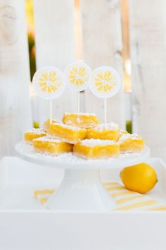 Host a Lemonade Stand this Summer!Everyone loves a sweet treat to go with their lemonade! These lemon treat toppers are easy to make and such a darling touch! See more on The TomKat Studio!