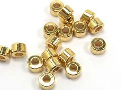 Schlichte Metallperle, Walze, 6x4mm, vergoldet, 10 Stück;  N154