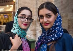 Two young Iranian women sport Louis Vuitton-inspired headscarves. The country has also seen a surge in fake designer goods, from Louis Vuitton smartphone cases to colourful, sequin-covered scarves and chadors