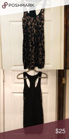 Express leopard sequin dress Black/Gold Express Sequin leopard print dress. Sequins in front. Solid black in the back. Racer back style in back. 58% Pima corton 39 % Modal 3% spandex. Hugs body. Fits super sexy. Express Dresses Midi