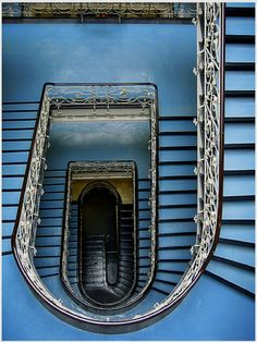 lovely blue stairs and I adore the wrought iron railings