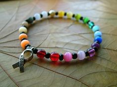 Custom Rainbow Cat's Eye Beaded Cancer by AuntMarysLegacy on Etsy, $15.00