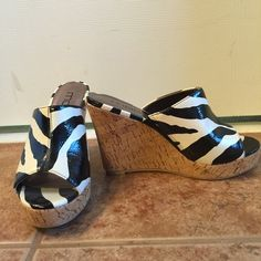 Zebra print shoes Practically new, worn maybe twice zebra wedges . Gorgeous shoes to dress up or down. Moda Shoes Wedges