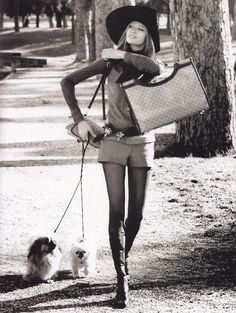 1971 in the Borghese Gardens of Rome. Model Veruschka (Vera Gräfin von Lehndorff-Steinort) in Gucci outfit and bag, hat by Remo Argenti, and Mario Valentino boots. Photo by Henry Clarke (B1917 - D1996)