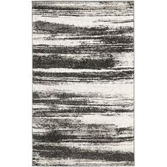 This gorgeous dark and light grey deco rug is perfect for your room. This rug pairs modern style with luxurious comfort. Made of high-density polypropylene, it is durable and easy to maintain, and the contemporary design has an abstract pattern.