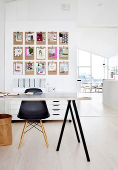 such a fun idea! hanging clipboards on the wall in a home office... organization in a fun way. :)