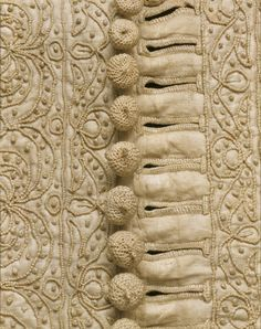 Man's doublet. Glazed linen embroidered with linen thread. England, 1635-40.