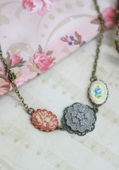 """Covington Flower Indie Charm Necklace 42.99 at shopruche.com. Beautifully handmade, this dark brass chain necklace holds embossed floral pendants.  Chain: 17"""" length, Pendant: 1"""" length"""
