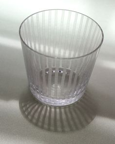 """Soba choko """"Yoroke jima"""" by Horiguchi Kiriko from Japan Suite  3.07""""D 2.75""""H 7.1oz $73 This glass illustrates the concept of yorokejima, which has various meanings associated with straying from a straight line. Take a close look at the design. From a distance, the lines appear uniform and parallel, but upon closer inspection, each is unique -- like individual stalks of bamboo growing together. A perfect glass for sake or wine, ... #Edokiriko #Kiriko"""