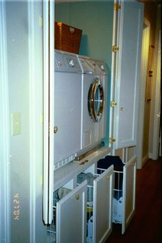 laundry closet - like the idea of elevating the machines to add storage underneath - maybe not so high though
