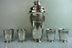 $1,600.00 Solid silver 900 shaker with Polish and Vietnam hallmarks, made in Poland for export, it is very beautifully decorated with raised scenes, and comes with four matching cups / goblets. Shaker's height 20.7 cm. Diameter at its widest point, 10.3 cm. Goblets' height 6.1 cm. Top diameter 5.8 cm. Weight, shaker & cups, 798 grams.