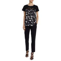 Laterale T-shirt Twin-Set nera e beige con ricamo e fantasia floreale
