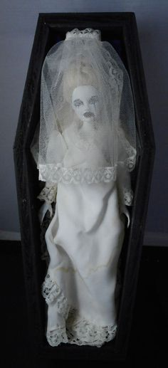 This item consists of the black painted wooden coffin with a gold (tone) crucifix. The coffin has a blue velvet under pad/mattress and pillow with a matching blanket. This is a remixed doll. She has a Barbie head on a slightly shorter Tinkerbell body. | eBay!