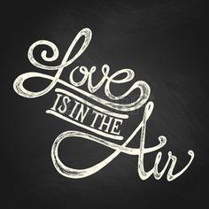cartel retro: El amor está en el aire - cotizaciones a mano, blancos en la pizarra