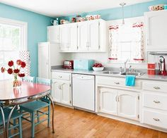 """""""White Retro Kitchen / laundry Idea with Red accents.  Here is beadboard used as backsplash.  Would it look okay with either red subway tile accent or stainless steel subay tile accent in the middle of backsplash?"""