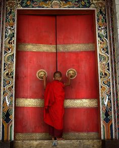 A Buddhist monk enters the formidable doors of Trongsa Dzong, the ancestral home of Bhutan's monarchy. The Himalayan kingdom of Bhutan has sat in isolation for thousands of years and only recently been thrust into the glare of modern times after centuries of solitude. This Buddhist kingdom, high in the Himalayas, had no paved roads until the 1960s, was off-limits to foreigners until 1974, and launched television only in 1999. In 1972, the country stop relying on Gross Domestic Product as…