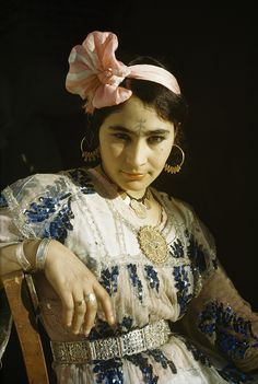 An Ouled Nail woman in Algeria wears a tattoo that is customary for dancers, 1949. Photograph by Maynard Owen Williams, National Geographic Creative