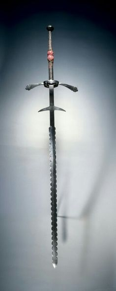 Two-Handed Sword, 1550-1600 Germany, second half of 16th Century steel; leather and wood grip, cloth-covered middle, Overall: l. 191.50 cm (75 3/8 inches); Blade: l. 144.80 cm (57 inches); Quillions: w. 41.50 cm (16 5/16 inches); Grip: l. 40.70 cm (16 inches); Ricasso: l. 33.40 cm (13 1/8 inches). Gift of Mr. and Mrs. John L. Severance 1919.68