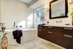 Free standing Blu bathtub with Love me waterfall faucet and Carrara mosaic heating floors Waterfall Faucet, Beautiful Bathrooms, Dark Wood, Corner Bathtub, Vanity, Construction, Lindbergh, Flooring, Carrara