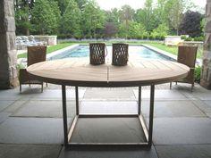 round wooden outdoor table by Munder Skiles via Gardenista