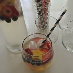 White wine, 2 cups fresca, 2 cups sparkler water, cute up strawberries,pineapple and blueberries, fun festive drink for memorial day!