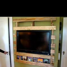 Pallet tv mount with extra storage.