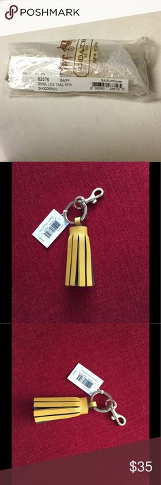 "New coach sunflower leather tassel key fob/ charm Brand new still wrapped in original packaging coach sunflower leather tassel key fob/charm. Sunflower yellow color. 2.5"" long. Will come to you like the first picture. Coach Accessories Key & Card Holders"