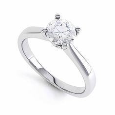 A beautiful diamond engagement ring in 18ct white gold with tapered shoulder and a four prong claw. Featuring a stunning single round brilliant diamond to maximise sparkle. Ring profile: Court #engagement #diamond #ring #roundbrilliant #singlestone #solitaire #sparkle #jewellery