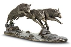 """Wolf Trio Sculpture Moving as one, a trio of wolves leaps in unison across a stream. Wolves symbolize loyalty and unity, a oneness with the pack and with the land. Highly-detailed sculpture of wolves and their environment lets your imagination run with the pack. Bronze-finish heavyweight resin with subtle handpainted details. 14 1/2"""" long x 6 1/2"""" high. Gift wrap and rush delivery not available."""