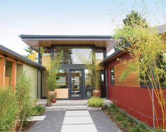 Modern Exterior colours, moss green, brick red and charcoal gray