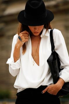 A white button down looks gorgeous paired with a chic black hat and pants.