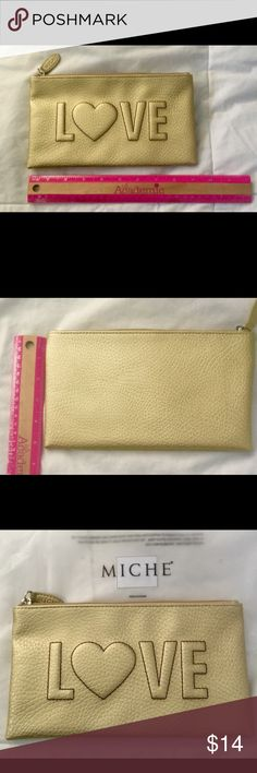 """MICHE Cosmetic Bag """"LOVE"""" raised imprint. NWT!! Another M•I•C•H•E Goodie """"Bag"""" you'll be hard pressed to find! A slightly matte metallic gold on the outside with a pink lining. Great for Cosmetics, as a Pen/Pencil Holder, and Nail Care Items (like A fingernail file, lotion, touch-up polish, etc.). PLUS...FREE-🐝s of your choosing OR my selection..as a surprise just for you! (if the latter, please share """"favs""""...i.e. scarves, jewelry, notepads, as well as your favorite colors! 👏👍🗣, """"RETAIL…"""